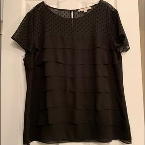 Black blouse with ruffle and mesh polka dot detail